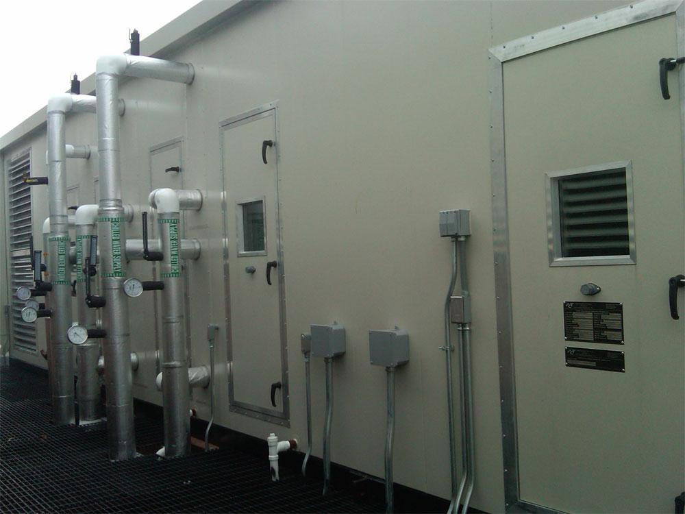 Heath Care: Custom operating room air handling unit with O/A sub-cooler